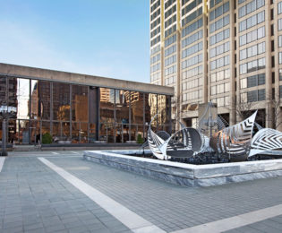 Plaza with sculpture outside of 2Hopkins