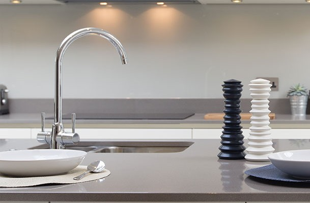 Sink with contemporary high-arc faucet in kitchen island at 2Hopkins apartments