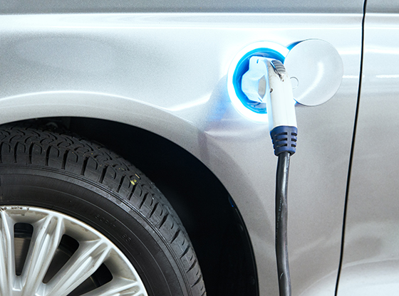 Close-up of electric charging plug attached to car