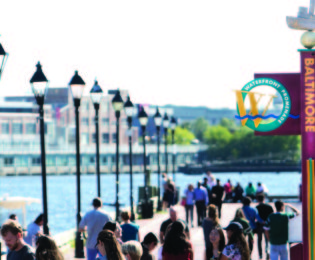 People strolling along Inner Harbor Waterfront Promenade on a sunny day
