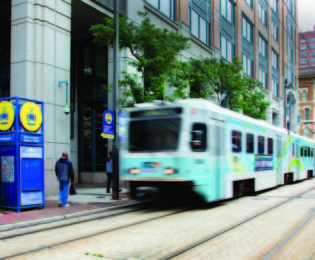 blurred photo of light rail train in downtown Baltimore