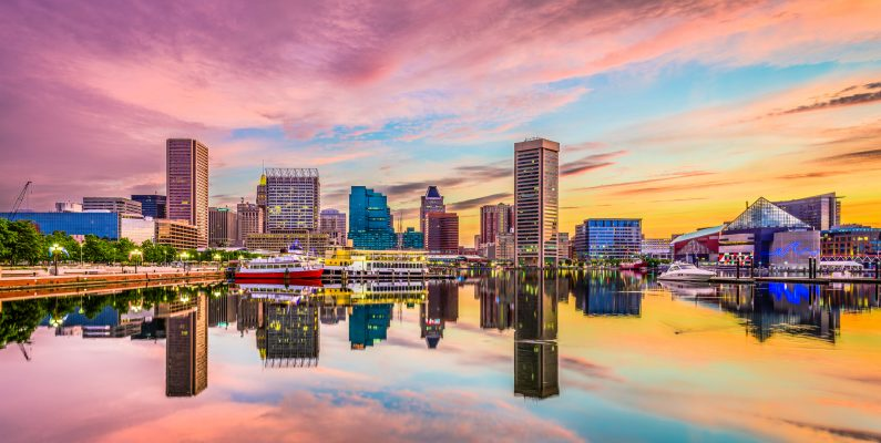 sunset photo of Inner Harbor Baltimore showing vivid colors of blues, pinks, oranges and reds