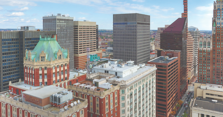 photo of tops of buildings in downtown Baltimore as seen from the roof of 2Hopkins apartments